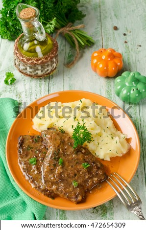 Chops from the liver with mashed potatoes. Rustic style
