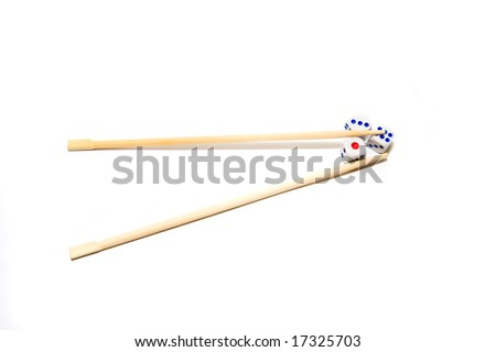 Chopsticks and dices on white background