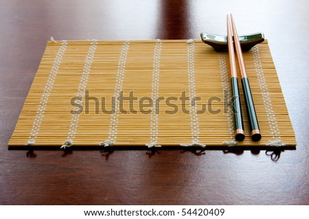 Chopsticks and table mat - stock photo