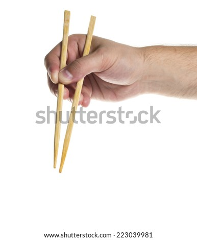 Chopsticks holded by chopsticks isolated on white background
