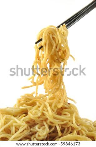 chopsticks holding oriental noodles on a white background - stock photo