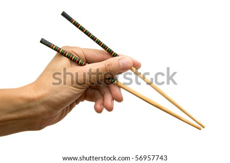 Chopsticks in a hand - stock photo