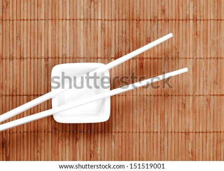 Chopsticks on a white ceramic cup - stock photo