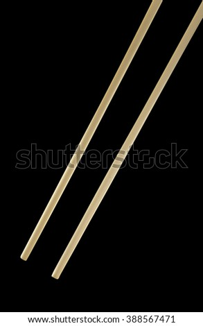 chopsticks on black background. - stock photo