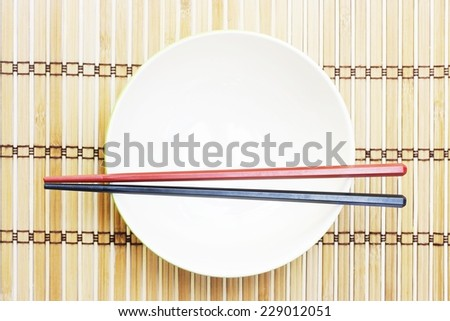 Chopsticks on Bowl  - stock photo