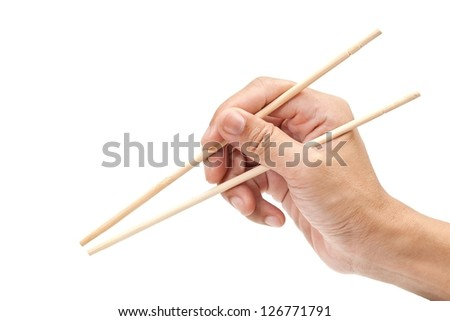 Chopsticks on hand - stock photo