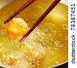 Chopsticks pick up fried dumplings - stock