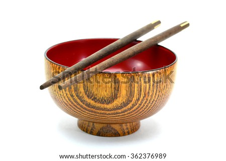 chopsticks with bowl on white background