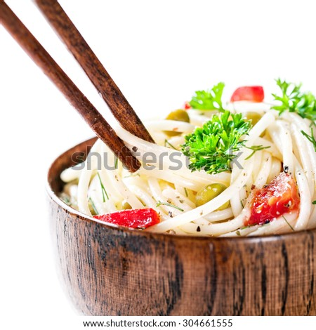 Chopsticks with Vegetarian noodles on white background - stock photo