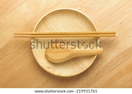 Chopsticks with wooden bowl - stock photo