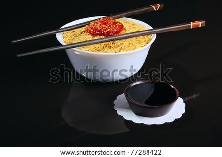 Chopstiks, bowl witn noodles, sauce - stock photo