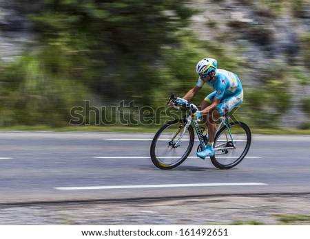 CHORGES, FRANCE- JUL 17:The Kazakhstani cyclist Alexey Lutsenko from  Astana Team pedaling during the stage 17 of Le Tour de France 2013, a time trial between Embrun and Chorges on July 17 2013