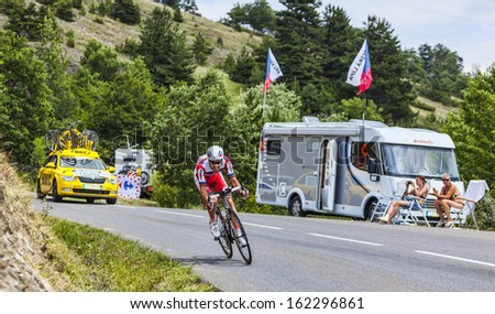 CHORGES, FRANCE- JUL 17:The Spanish cyclist Alberto Losada Alguacil from Katusha Team pedaling during the stage 17 of Le Tour de France 2013, a time trial between Embrun and Chorgeson July 17 2013
