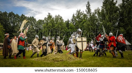 CHORZOW,POLAND, JUNE 9: Battle of medieval knights during a IV Convention of Christian Knighthood on June 9, 2013, in Chorzow