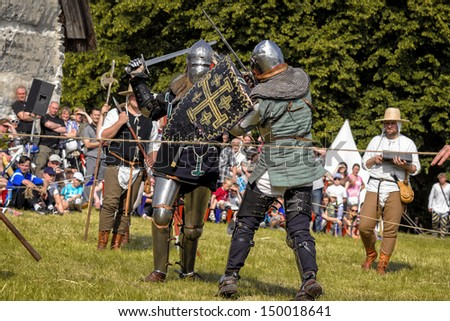CHORZOW,POLAND, JUNE 9: Fight of medieval knights during a IV Convention of Christian Knighthood on June 9, 2013, in Chorzow