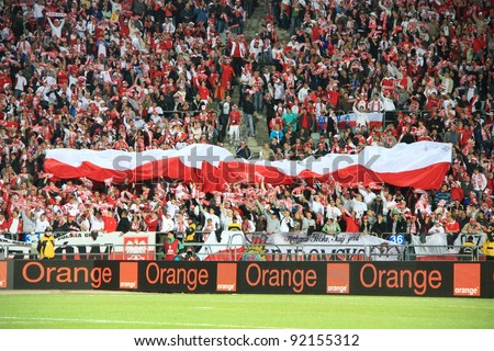 CHORZOW - SEPTEMBER 5: Polish fans cheer in Slaski stadium during the 2010 FIFA World Cup qualification match between Poland and Northern Ireland on September 5, 2009 in Chorzow, Poland. - stock photo