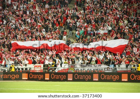 CHORZOW - SEPTEMBER 5: Polish fans in Slaski stadium during the 2010 FIFA World Cup qualification match between Poland and Northern Ireland on September 5, 2009 in Chorzow, Poland. - stock photo