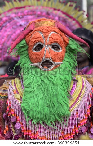 Chou dance performer dressed like demon to perform in the Chou Dance during a rally organized by W. B. Pradesh Congress on  occasion of World Human Rights Day on December 10, 2015 in Calcutta, India. - stock photo