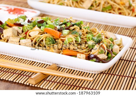 Chow mein - stir-fried noodles with vegetables - stock photo