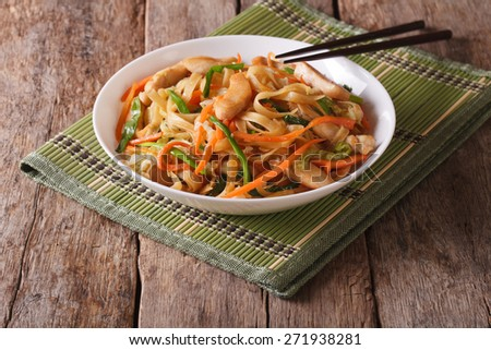 Chow mein with chicken and vegetables on the table. horizontal  - stock photo