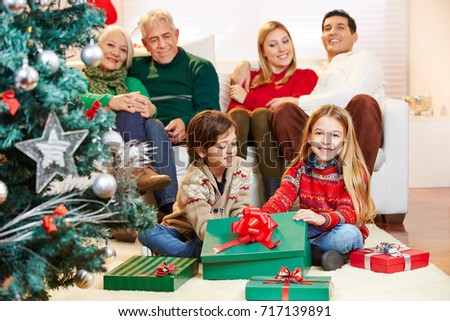 Chrildren making gift giving christmas eve stock photo 717139891 chrildren making gift giving at christmas eve with family negle Images