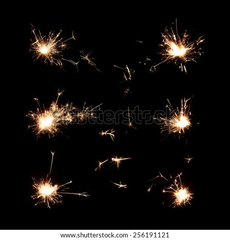 chrismas sparkler isolated on black set background six large fire sparks - stock photo