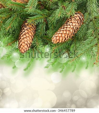 chrismas tree and pine cones on gray festive background with sparkles - stock photo