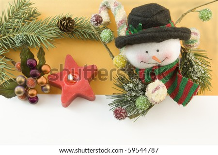 Chrismtas snowman with icy gumdrops, red star candle, fir branch, berry accent and copyspace - stock photo