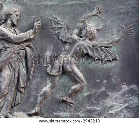 Christ and the devil - ancient bas relief, Pisa, Italy - stock photo