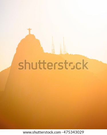 Christ Redeemer statue at Rio de Janeiro abstract shot at sunset time