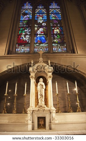 Christ Shrine Jesus Mary Joseph Manger Brith Stained Glass Christ Statue Saint Patrick's Cathedral New York - stock photo