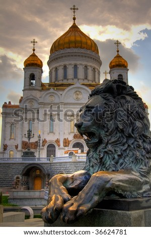 Christ the Savior Cathedral and statue of lion in Moscow, Russia - stock photo