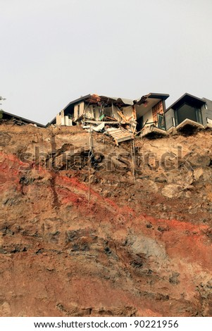 CHRISTCHURCH, CANTERBURY/NEW ZEALAND – JULY 11: A general view shows quake-damaged buildings in the suburb of Redcliffs  on July 11, 2011 in Christchurch, New Zealand. - stock photo