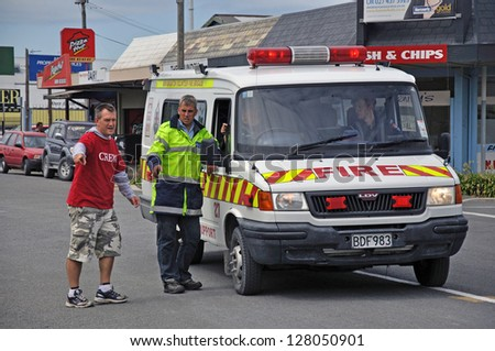 CHRISTCHURCH, NEW ZEALAND: February 26, 2011: Volunteers and fire service personnel work together after the 6.4 magnitude earthquake in Christchurch, South Island, New Zealand, 22-2-2011 - stock photo