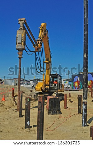 CHRISTCHURCH, NEW ZEALAND, JANUARY 11, 2013:  Builders drive in piles for the foundations of a new, hopefully earthquake-proof,  building in Christchurch, New Zealand on 11-1-2013. - stock photo