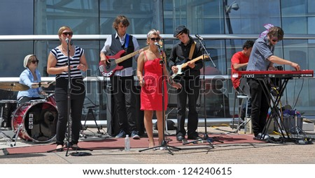 CHRISTCHURCH, NEW ZEALAND - JANUARY 28, 2011: Supership perform original Soul, Funk & Groove songs at the 18th World Buskers Festival on January 28, 2011 in Christchurch. - stock photo