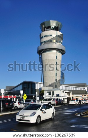CHRISTCHURCH, NEW ZEALAND, JULY 26 - A taxi departs from Christchurch Airport  in Christchurch, New Zealand on 26-7-2012. Tourism has slowed drastically since the big earthquake the previous year. - stock photo