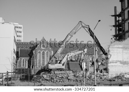 CHRISTCHURCH, NEW ZEALAND - JUNE 10, 2015: Ruins of buildings destroyed in the 2011 earthquake are still visible today in town - stock photo