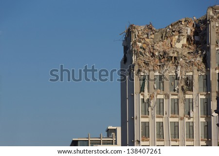 CHRISTCHURCH, NEW ZEALAND, NOVEMBER 16: Demolition of tall buildings continues in Christchurch, New Zealand, 16-11-2012. 182 people died in the 6.4 earthquake the previous year. - stock photo