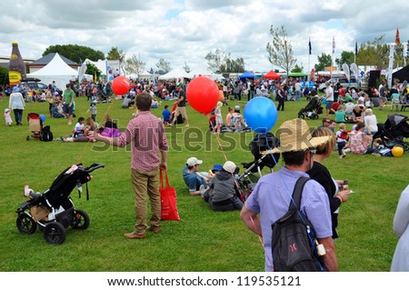 CHRISTCHURCH, NEW ZEALAND - NOVEMBER 16: Families Picnic at the 2012 Canterbury A&P Show fair ground on November 16, 2012 in Christchurch. - stock photo
