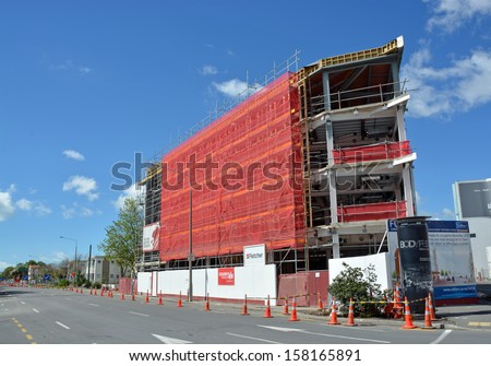 CHRISTCHURCH, NEW ZEALAND - OCTOBER 12, 2013:  New office block under construction on the corner of Victoria and Salisbury Streets after massive earthquake on October 12, 2013 in Christchurch. - stock photo