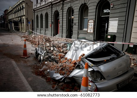 CHRISTCHURCH, NEW ZEALAND - SEPT 9:  A car lies crushed after a 7.1 magnitude earthquake that struck on 4 September. Strong aftershocks continue.  9 September 2010 in Christchurch, New Zealand. - stock photo