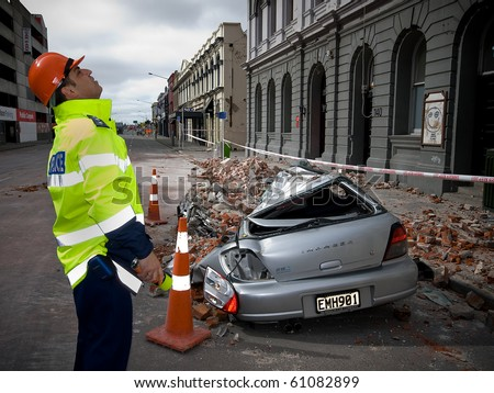 CHRISTCHURCH, NEW ZEALAND - SEPT 9:  Police inspect damage a 7.1 magnitude earthquake that struck on 4 September. Strong aftershocks continue.  9 September 2010 in Christchurch, New Zealand. - stock photo