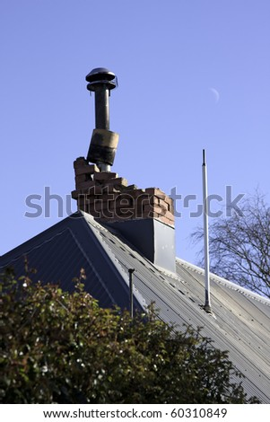 CHRISTCHURCH, NEW ZEALAND- SEPTEMBER 4:Image of a collapsed chminey caused by earthquake on Sept 4, 2010 in Christchurch.  The 7.1 earthquake hit at 4:35am - stock photo