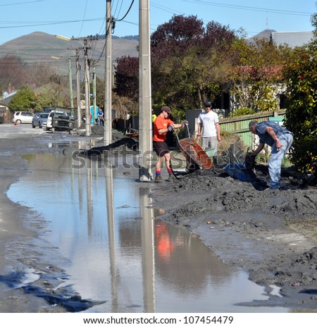 CHRISTCHURCH, NEW ZEALAND - SEPTEMBER 05: Residents dump tons of earthquake liquefaction from their houses into the streets on September 05, 2010 in Christchurch. - stock photo