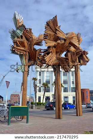 Christchurch, New Zealand - September 13, 2013; Woods From The Trees Sculpture by Regan Gentry on the corner of High and Tuam Streets. Made from recycled Rimu from demolished Christchurch houses. - stock photo