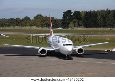 CHRISTCHURCH, NZ - MARCH 18: Qantas Jetconnect B737 aircraft on March 18, 2009 in Christchurch. In 2009, Qantas was voted the 6th best airline in the world by research consultancy firm Skytrax - stock photo