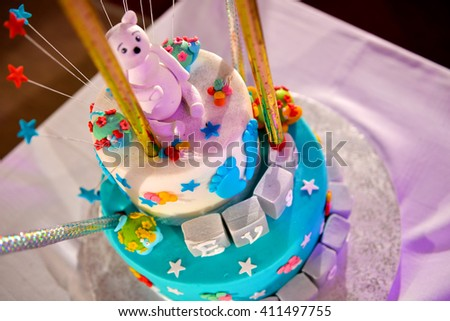 Christening cake with pink teddy bear - stock photo
