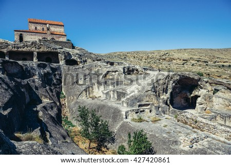 Christian Basilica in ancient rock-hewn town called Uplistsikhe in Georgia - stock photo