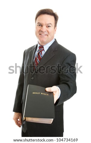 Christian businessman, minister, or missionary, holding a bible.  Isolated on white. - stock photo